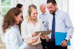 Business people in office having meeting Royalty Free Stock Photo