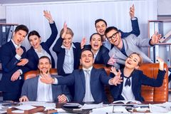 Business people office life of team people are happy with hand up. Business people office life of team people are happy with hand up sitting table. Cabinets royalty free stock photography