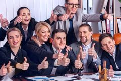 Business people office life of team people are happy with thumb up . Royalty Free Stock Photo