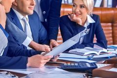 Business people office life of team people working with papers. Royalty Free Stock Image