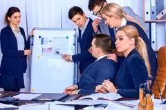 Business people office life of team people working with papers. Royalty Free Stock Images