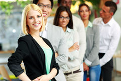 Business people in the office lined up Royalty Free Stock Photo