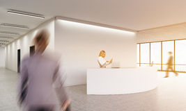 Business people in office lobby. Businessmen in office lobby with reception counter and panoramic windows. Concept of business meeting. 3d rendering. Mock up Royalty Free Stock Image