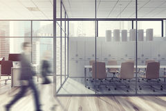 Business people in office lobby, glass wall Royalty Free Stock Photo