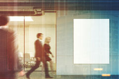 Business people in an office lobby, poster. Side view of a glass meeting room with a poster hanging on a gray wall. Glass walls, a long table with white chairs Royalty Free Stock Photo