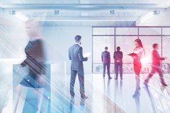 Business people in office lobby, skyscraper royalty free stock image