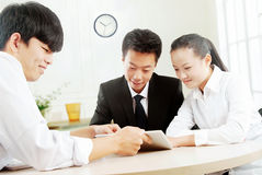 Business people in office meeting to discuss Stock Images