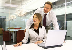 Business people in an office mm Stock Photos