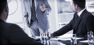 Business people in office at presentation Stock Images