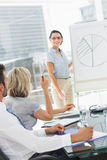 Business people in office at presentation Stock Image
