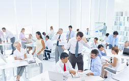 Business People in the Office on Rush Hour Royalty Free Stock Image