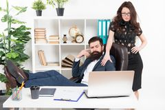 Business people and office staff. secretary personal assistant. Typical office life. Man bearded hipster boss sit. In leather armchair office interior. Boss and royalty free stock photo