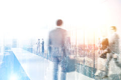 Business people in an office, sunny day. Business people are in a modern office. Cityscape in the foreground. Polygons. Concept of an international company stock image