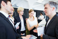 Business people in office talking to each other stock photo