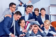 Business people office. Team people are unhappy with their leader. Intern men manager does not cope with his duties. Crowd in stress throw up their chief`s Royalty Free Stock Image