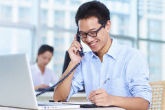 Business people in the office. Young Asian business people in the Office Stock Photography
