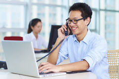 Business people in the office. Young Asian business people in the Office Stock Images