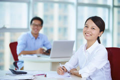 Business people in the office. Young Asian business people in the Office Royalty Free Stock Images