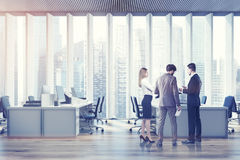 Business people in an open space office, toned Royalty Free Stock Photos