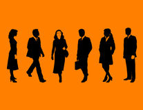 Business people on orange Stock Image