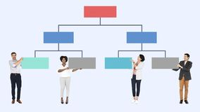 Business people with an organizational chart royalty free stock photo