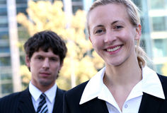 Business people outdoors. Businesswoman and man standing outdoors Royalty Free Stock Photos