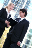 Business people outdoors. Businesswoman and man standing outdoors Stock Photography