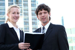Business people outdoors. Businesswoman and man standing outdoors Stock Images