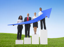Business People Outdoors Holding Increasing Arrows Stock Images