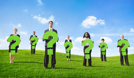 Business People Outdoors Holding Question Marks Stock Photos