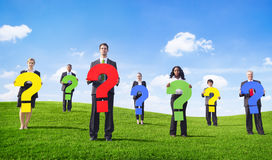 Business People Outdoors Holding Question Marks Stock Photography