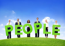 Business People Outdoors Holding the Text People Stock Photography