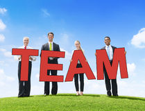 Business People Outdoors Holding Text Team Stock Images