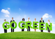 Business People Outdoors Holding Texts Go Green.  Royalty Free Stock Photo