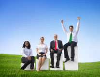 Business People Outdoors Sitting on a Bar Graph Stock Photo