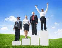 Business People Outdoors Standing on a Bar Graph Stock Photography