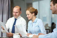 Business people with papers meeting in office Stock Images