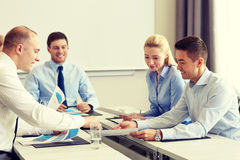 Business people with papers meeting in office Royalty Free Stock Photography