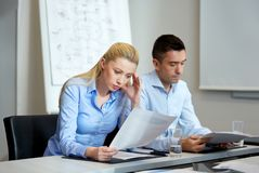 Business people with papers working at office Royalty Free Stock Photography