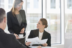 Business people with paperwork during coffee break Royalty Free Stock Photography