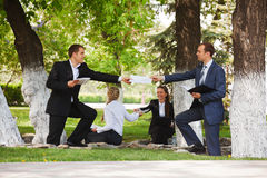 Business people in a park Royalty Free Stock Image