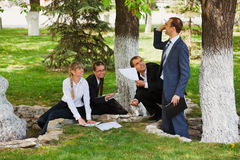 Business people in a park Stock Photography