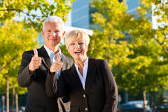 Business people in a park outdoors royalty free stock photography