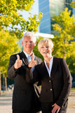 Business people in a park outdoors Royalty Free Stock Photos