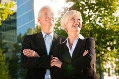 Business people in a park outdoors Stock Photos