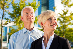 Business people in a park outdoors Stock Photography