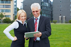 Business people in park with tablet Royalty Free Stock Photos