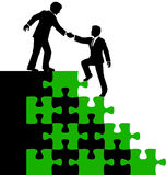 Business people partner help find solution. Business consultant mentor or teamwork helps associate find problem puzzle solution Royalty Free Stock Photography