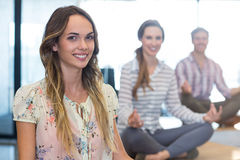 Business people performing yoga in office Royalty Free Stock Images
