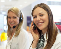 Business people with phone and headphones giving support. In help desk office to customers, manager giving training and education instructions Stock Image
